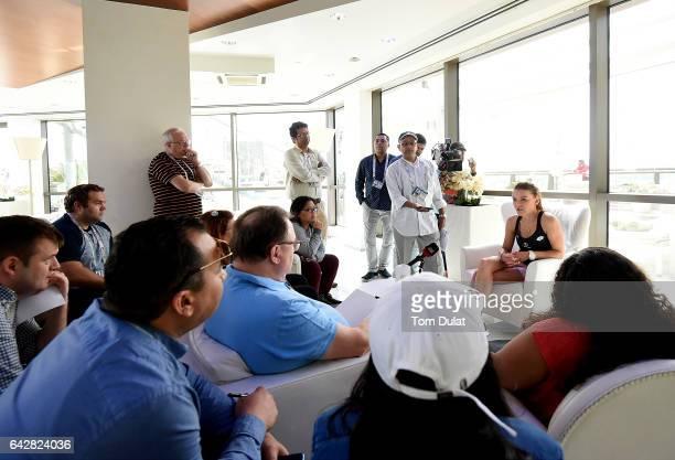 Agnieszka Radwanska of Poland speaks to the media during day one of the WTA Dubai Duty Free Tennis Championship at the Dubai Tennis Stadium on...