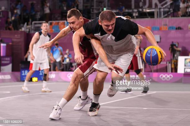 Agnis Cavars of Team Latvia and Ilia Karpenkov of Team ROC compete for the ball in the 3x3 Basketball competition on day five of the Tokyo 2020...