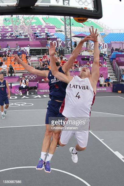 Agnis Cavars of Team Latvia drives to the basket against Dejan Majstorovic of Team Serbia in the 3x3 Basketball competition on day three of the Tokyo...