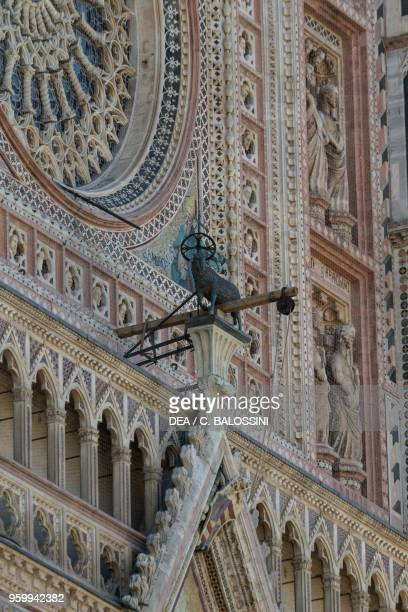 Agnus dei by Matteo di Ugolino da Bologna top of the central gable of the entrance in the facade of Orvieto cathedral Umbria Italy 14th century