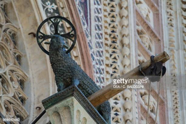 Agnus dei by Matteo di Ugolino from Bologna top of the central gable of the entrance in the facade of Orvieto cathedral Umbria Italy 14th century