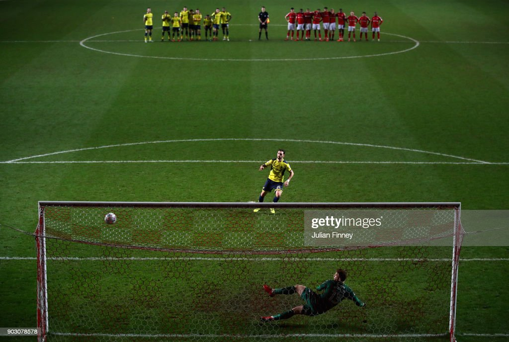 Agon Mehmeti of Oxford scores the winning penalty in the shoot out after the final score was 1-1 during the EFL Checkatrade Trophy Third Round match between Charlton Athletic and Oxford United at The Valley on January 9, 2018 in London, England.