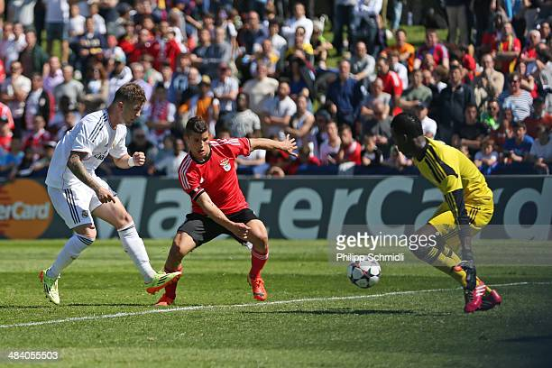 Agoney Gonzalez of Real Madrid fails to score against Rafael Ramos and goalkeeper Thierry Graca of SL Benfica during the UEFA Youth League Semi Final...