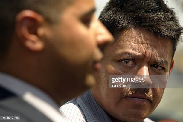 Agony and distress all over his face Jose Gonzalez father of missing boy David Gonzalez right listens as San Bernardino County Sheriff Deputy Jesse...
