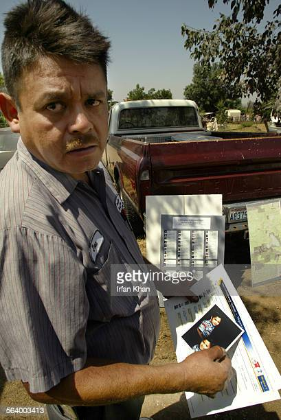 Agony and distress all over his face Jose Gonzalez holding photo of his missing son David Gonzalez meets the media at his residence in Perris on...