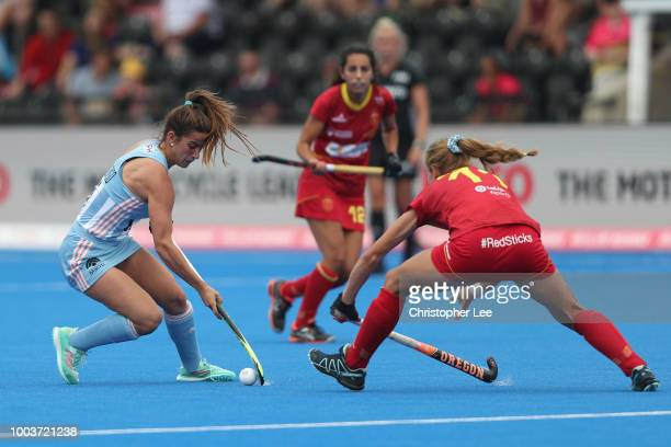 Agostina Alonso of Argentina turns away from Cristina Guinea of Spain during the Pool C game between Argentina and Spain of the FIH Womens Hockey...