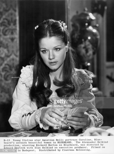 Agostina Belli with cards in a scene from the film 'Bluebeard' 1972