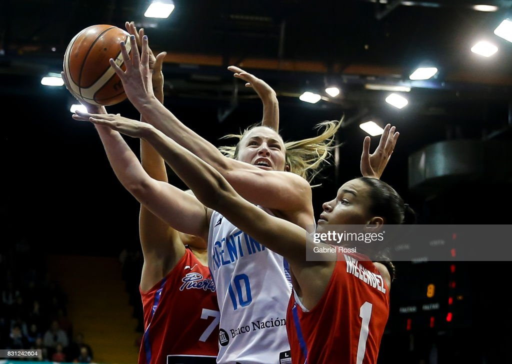 Agostina Burani of Argentina fights for the ball with Tayra Melendez of Puerto Rico during a match between Argentina and Puerto Rico as part of the FIBA Women's AmeriCup Semi Final at Obras Sanitarias Stadium on August 12, 2017 in Buenos Aires, Argentina.
