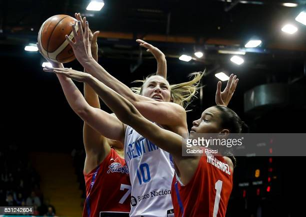 Agostina Burani of Argentina fights for the ball with Tayra Melendez of Puerto Rico during a match between Argentina and Puerto Rico as part of the...