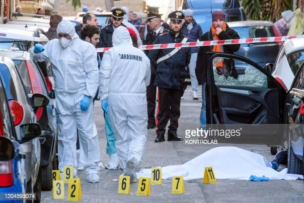 Agostino Alessandro Migliore killed in a mafia ambush, at dawn under his house. He was the brother of a mafia boss currently in prison. On the scene...
