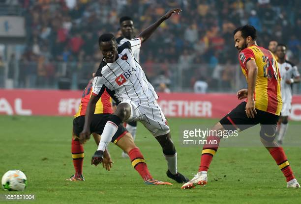 Agosto's defender Jose Ganga fights for the ball with Esperance de Tunis' Taha Khenissi and Anis Badri during the CAF Champions League semifinal...