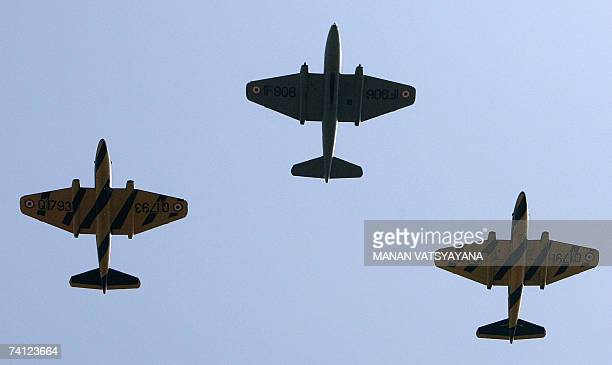 Indian Air Force Canberra jet bombers take part in their last flight during a ceremony to phase-out the Canberra bombers at the Air Force station in...