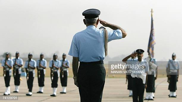Indian Air Force Chief of Staff, Air Marshal Fali Homi Major acknowledges a guard of honor during a ceremony to phase-out the Canberra bombers at the...