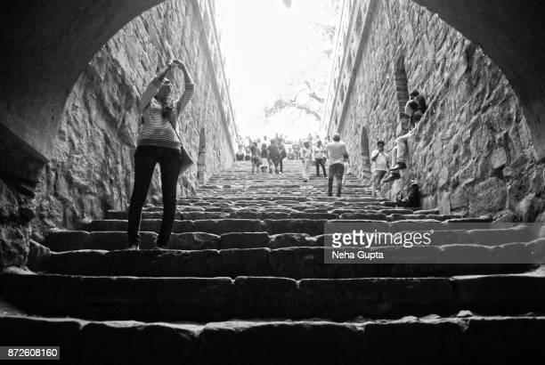 agrasen ki baoli - a young tourist - agrasen ki baoli stock pictures, royalty-free photos & images
