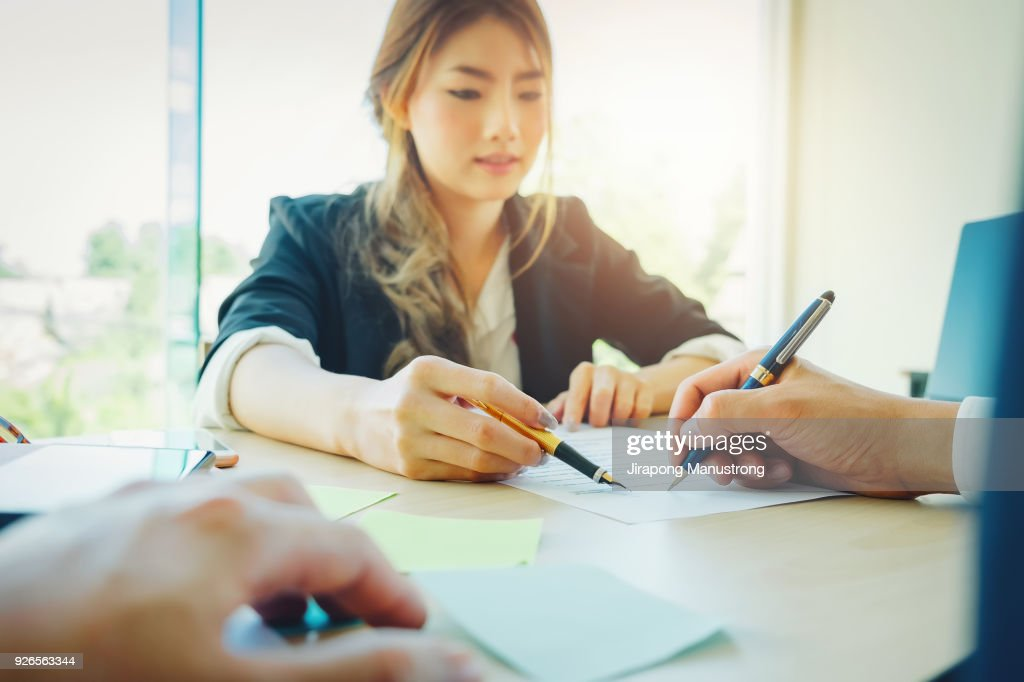 Agreement paper,estate agent gives pen and documents agreement with customer to sign contract. : Stock Photo