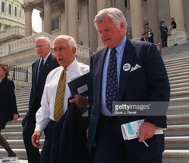 AGREEMENTSens Patrick Leahy DVt Frank Lautenberg DNJ and Ted Kennedy DMass walk down the Senate steps to a bus to go to the White House for President...