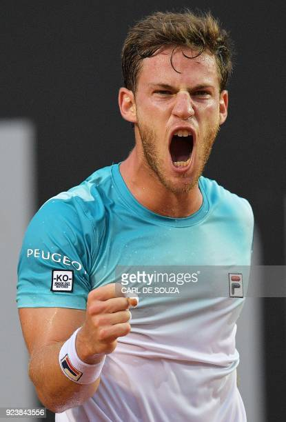 Agrentina's Diego Schwartzman celebrates after winning the first set during his ATP World Tour Rio Open semi final single tennis match against...