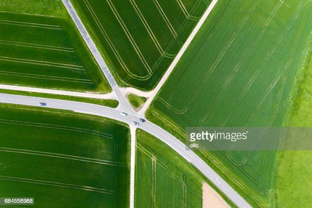 agricultural area and thoroughfare - aerial view - crossroad stock pictures, royalty-free photos & images