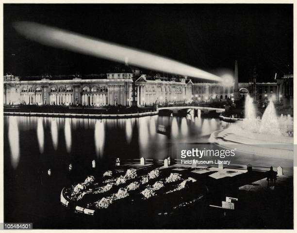 Agricultural Building at Night from North West With spotlight or beacon of light shining across the lagoon Large photographic print from 'The White...