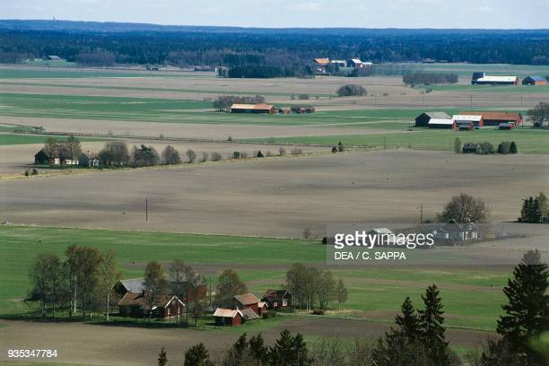 Agricultural landscape with farms near Lidkoping Gotaland Sweden