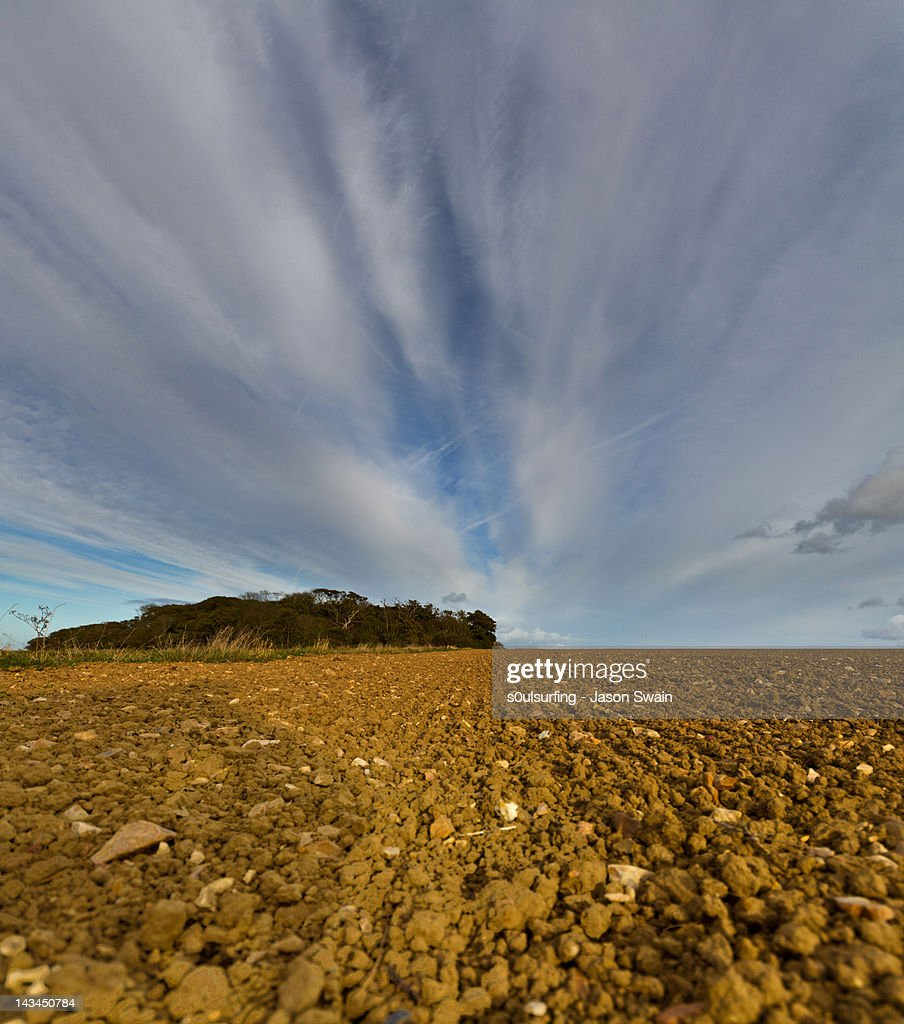 Agricultural scene and crazy altocumulus skies : Stock Photo