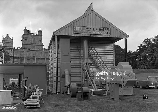 Agricultural stand at the Royal Show at Wollaton Hall Nottingham Nottinghamshire July 1954 Workers take a break whilst building a trade show stand...