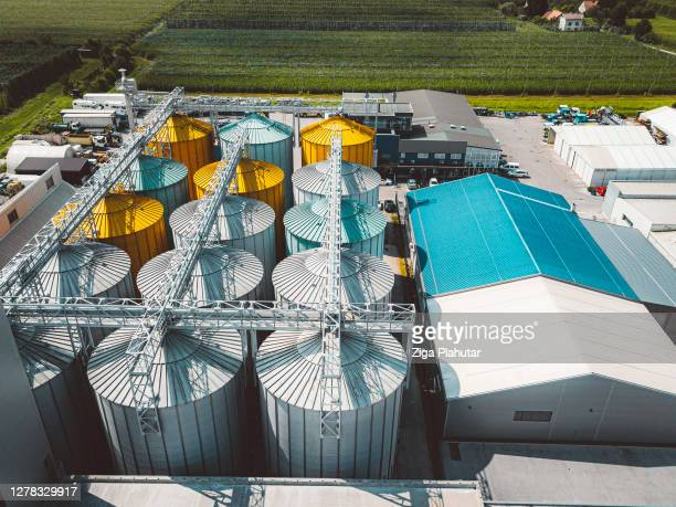 agricultural storage facility with grain silos - industrial district stock pictures, royalty-free photos & images