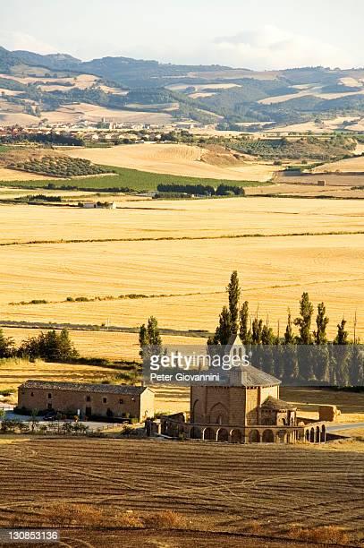 Agricultural used valley and the Chapel Santa Maria Eunate, Puenta La Reina, Navarra, Spain