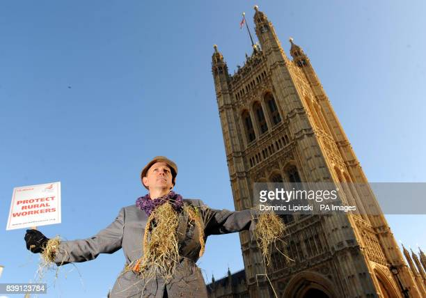 Agricultural Worker Dave Hide from Horsham dressed as a scarecrow as he takes part in a demonstration outside the Houses of Parliament in Westminster...