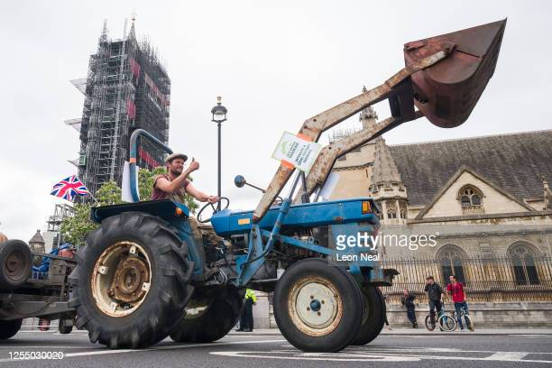 Agricultural workers and farmers demonstrate with a tractor outside the Houses of Parliament as they call for protection for the British farming...