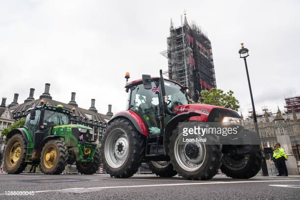 Agricultural workers and farmers demonstrate with tractors outside the Houses of Parliament as they call for protection for the British farming...