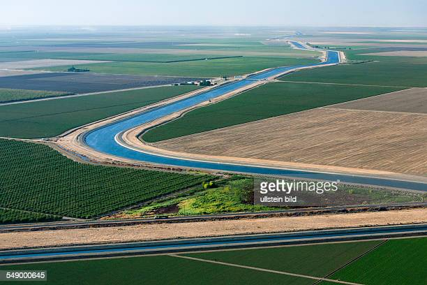 Agriculture in the Central Valley. This canal is part of the California Aqueduct, a system of canals, tunnels and pipelines that conveys water...