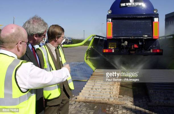 Agriculture Minister Elliot Morley watches a milk tanker go through a high pressure wash before being disinfected at the Zenith Milk distribution...