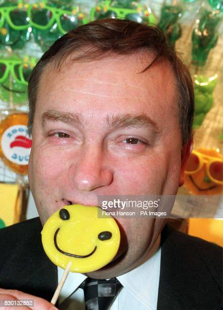 Agriculture Minister Nick Brown samples a Daisy Galore lollipop after opening the 11th International Food and Drink Exhibition at London's Earls...