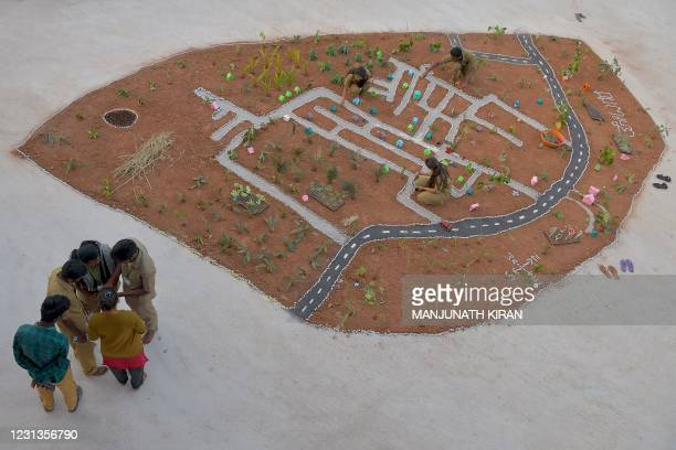 Agriculture Science final year undergraduate students create a topographic map of Thotagere Village as part of their project, on the outskirts of...