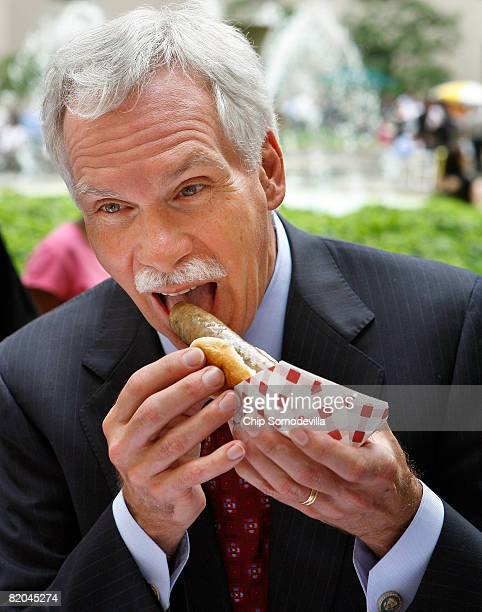 S Agriculture Secretary Edward Schafer takes a bite of a Hatfield brand Nationals Sausage during the American Meat Institute's Annual Hot Dog Day...