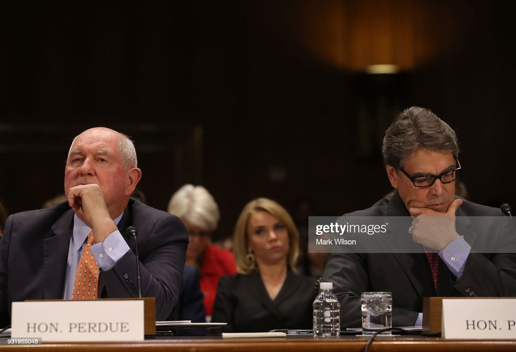 Agriculture Secretary Sonny Perdue, (L), and Energy Secretary Rick Perry, appear before the Senate Commerce, Science and Transportation Committee, on March 14, 2018 in Washington, DC. The committee is hearing testimony on President Donald Trump's plan to rebuld the nations infrastructure.