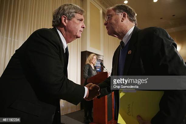 S Agriculture Secretary Tom Vilsack and Rep Sam Farr shake hands during a news conference to launch the US Agriculture Coalition for Cuba at the...