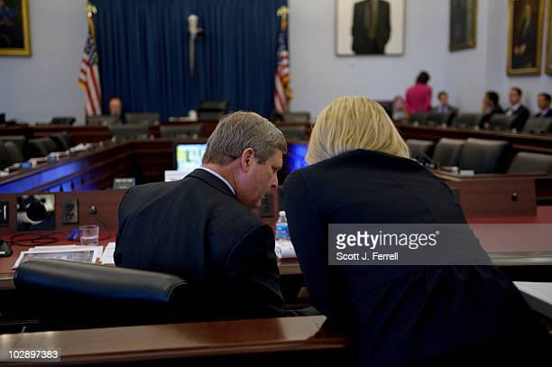 July 14: U.S. Agriculture Secretary Tom Vilsack talks to an aide during a break in the House Budget hearing on the impact of the American Recovery...