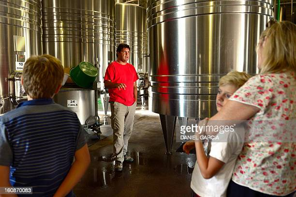 Agriculturist Cristian Allamand speaks to tourists at Joaquin Villanueva farm part of the Luminis winery project in the district of Perdriel Lujan de...
