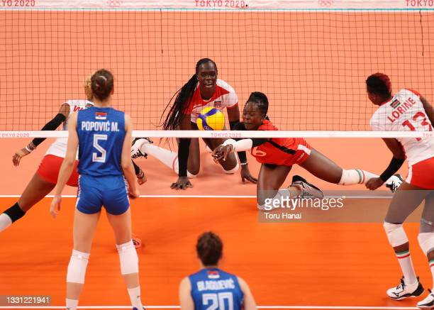 Agripina Khayesi Kundu of Team Kenya dives to return the ball against Team Serbia during the Women's Preliminary - Pool A volleyball on day six of...