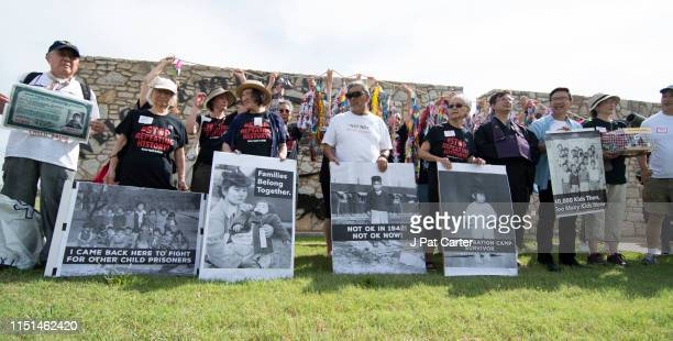 Agroup of Japanese Americans who held in concentration camps in WWII pose with photos of themselves, during a press conference on June 22, 2019 in...