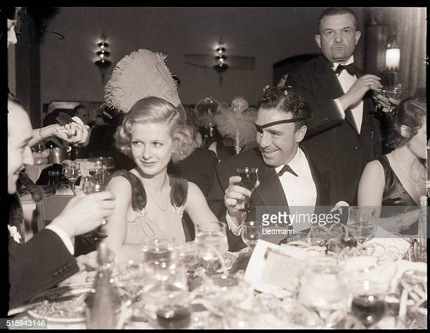 1/1/1933 Agua Caliente Mexico Joan Bennett screen star and Raoul Walsh director make whoopee at their table in the Agua Caliente Hotel in Agua...