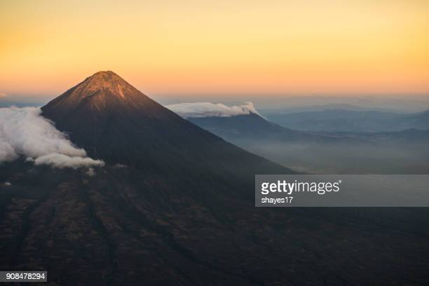 agua volcano sunset - guatemala stock pictures, royalty-free photos & images
