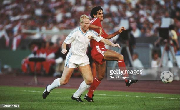 Aguas of Benfica challenges Ronald Koeman of PSV Eindhoven during the 1988 UEFA European Cup final at the Neckarstadion in Stuttgart Germany PSV...