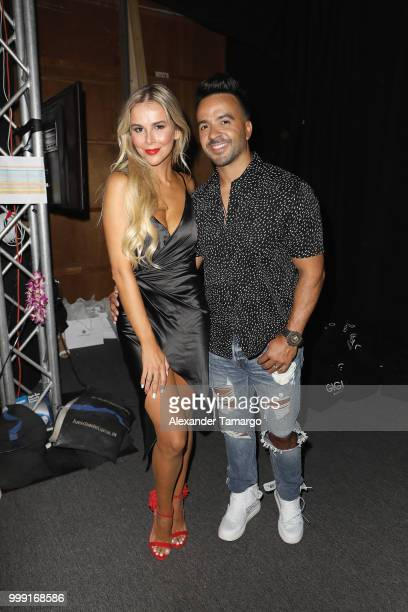 Agueda Lopez and Luis Fonsi backstage for Luli Fama during the Paraiso Fashion Fair at The Paraiso Tent on July 14 2018 in Miami Beach Florida
