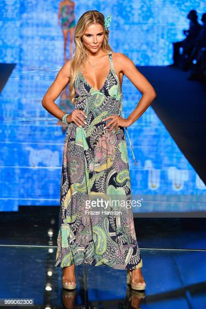 Agueda Lopez walks the runway for Luli Fama during the Paraiso Fashion Fair at The Paraiso Tent on July 14 2018 in Miami Beach Florida