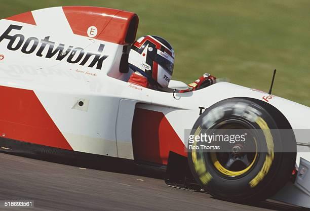 Aguri Suzuki of Japan drives the Footwork Mugen Honda Footwork FA14 Mugen Honda V10 during the British Grand Prix on 11th July 1993 at the...