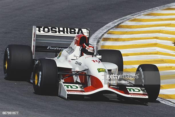 Aguri Suzuki of Japan drives the Footwork Mugen Honda Footwork FA14 Mugen Honda V10 during the Brazilian Grand Prix on 5 April 1992 at the Autodromo...