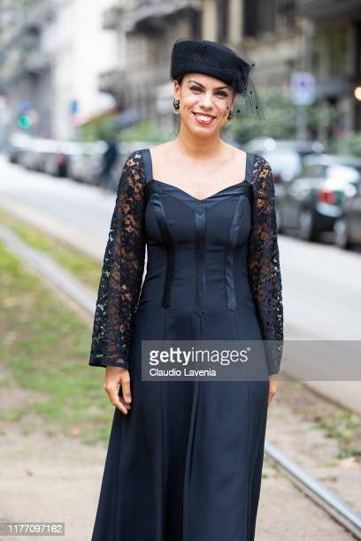 Agus Cattaneo wearing a black midi dress and black hat is seen outside the Dolce e Gabbana show during Milan Fashion Week Spring/Summer 2020 on...